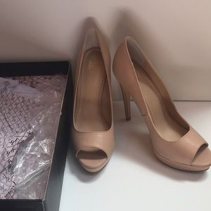Nude peep toe pumps